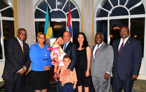 At the Farewell Reception in honour of Cuban Ambassador His Excellency Ernesto Soberon Guzman on Wednesday at the British Colonial Hilton are, from left: Minister of Agriculture and Marine Resources, the Hon. V. Alfred Gray; Minister of Financial Services, the Hon. Hope Strachan; Ambassador Guzman, Mrs. Guzman and their children; Deputy Prime Minister and Minister of Urban Development, the Hon. Philip Davis; and Minister of State in the Ministry of Works, the Hon. Arnold Forbes. (BIS Photo/Kemuel Stubbs)