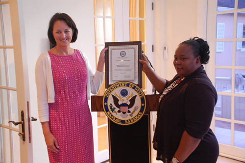 U.S. Chargé d'Affaires a.i. Lisa Johnson formally recognized Ms. Vivette Moss of the Registrar General's Office for her help in the verification of visa applicants' biographical information which is used to detect and prevent identity fraud.