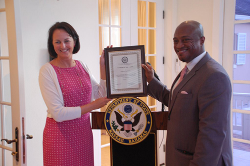 U.S. Chargé d'Affaires a.i. Lisa Johnson formally recognized Carnival Cruise Line's CareTeam for their efforts assisting American citizens facing medical, family, and legal emergencies.
