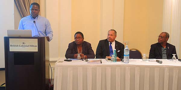 At the lectern, State Minister for Investment Hon. Khaalis Rolle is pictured addressing the media and stakeholders at a press briefing on Saturday (September 19) at the Hilton Hotel to provide an update on the work of the National Development Plan Secretariat. The diagnostic phase is complete. Seated from left are Dr. Nicola Virgill-Rolle, Director of Economic Development Planning; Dr. Rodney Smith, President of the College of The Bahamas; and Felix Stubbs, Chairman – National Development Plan Secretariat.