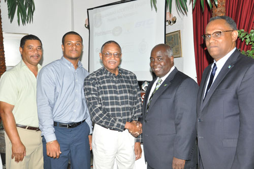 HONOUREE -- The Northern Branch of the Bahamas Society of Engineers on Thursday honoured one of their own -- Paul Lockhart during the 2015 Grand Bahama Annual Meeting and Workshop Luncheon at the Ruby Swiss Restaurant. Shown from left are: Darious Williams, Master of Ceremonies; Remington Wilchcombe, Northern Branch President; Mr. Lockhart; Deputy Prime Minister and Minister of Urban Development, the Hon. Philip Davis, who was the guest speaker for the event; and Minister for Grand Bahama, the Hon. Dr. Michael Darville. (BIS Photo/Andrew Miller)