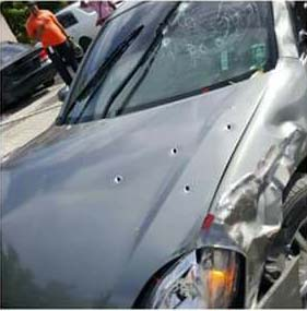 Francis' vehicle shot up yesterday by killers.