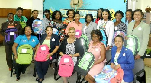 Pictured: Front(seated L to R) – Terah Sweeting (Eta Psi Omega), Shayne Sweeting (One Million Backpacks Committee Chairperson), Lillian Quant-Forbes (Deputy Director of the Department of Social Services), Mavis Collie-Johnson (Eta Psi Omega) and Ida Poitier-Turnquest (Eta Psi Omega).