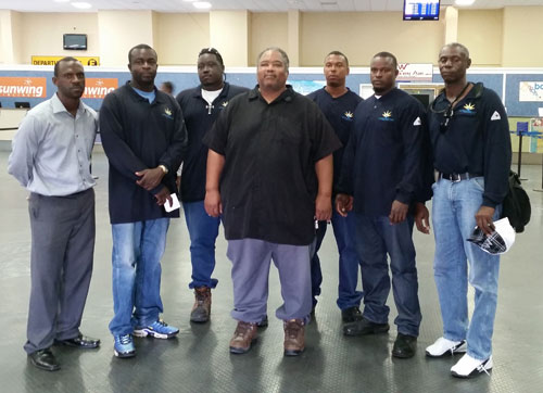 Grand Bahama Power Linesmen headed to the Southern Bahamas to help with restoration efforts depart Grand Bahama International Airport- Domestic Terminal. Pictured (left to right) are Delano Arthur, Manager of Operations and Maintenance for T&D, Andre Spence, David Parker Jr., Troy Mackenzie, Director of Transmission & Distribution, Chad Bartlett, Arthur Spencer, and Patrick Laing, Team Leader.