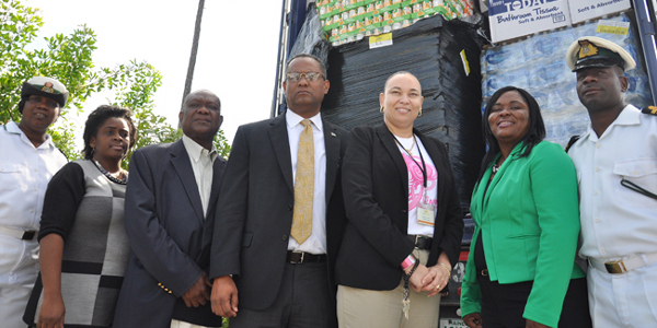 Minister for Grand Bahama, the Honourable Dr. Michael Darville accepts a 40-foot container full of food supplies and water from Sawyer's Fresh Market on Friday morning for hurricane victims in the Central and Southern Bahmas. Left to right in the photo are Paulette Higgs, Royal Bahamas Defense Force; Geraldine Pinder, NEMA; Charles King, Administrator, City of Freeport; Dr. Darville, Minister for Grand Bahama; Kayla Prudelus, Sawyer's Store Manager; Dr. Joneth Edden, Ministry for Grand Bahama; Omar Saunders, Officer-in-Charge/ RBDF on Grand Bahama. (BIS Photo/Andrew Miller)