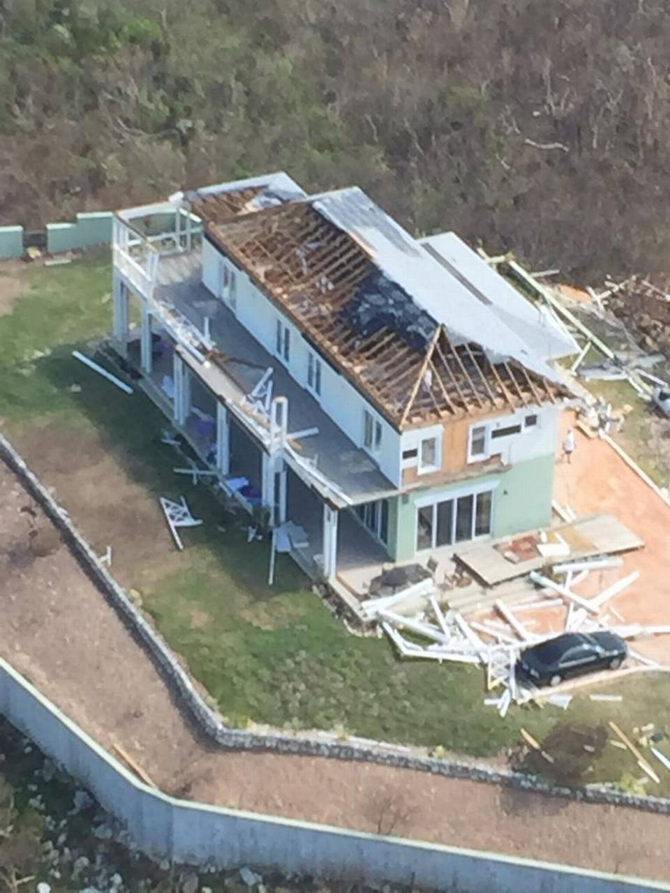 A home in the central portion of Long Island in the Bahamas sustained significant damage from Hurricane Joaquin, which dumped torrential rain and high winds on the island chain on Saturday. Mike Fernandez