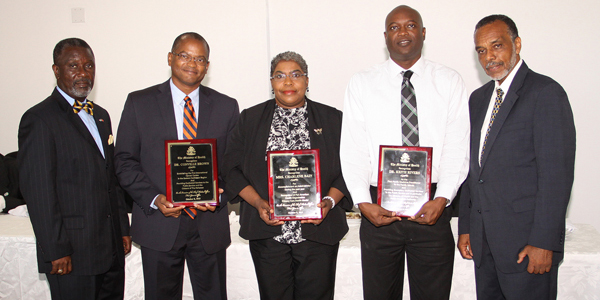 Chief Medical Officer, Dr. Glen Beneby (far right) and Permanent Secretary at the Ministry of Health, Marco Rolle (left) flank the recipients of the first-ever Chief Medical Officer Award for Outstanding Achievement. The initial recipients were (from second left) Dr. Conville Brown (entrepreneurship); Mrs. Charlene Bain (public health administration); and Dr. Keith Rivers, a former lab technician who was the first graduate of the Family Medicine Specialty School to be assigned to a Family Island. (BIS Photo/Patrick Hanna)