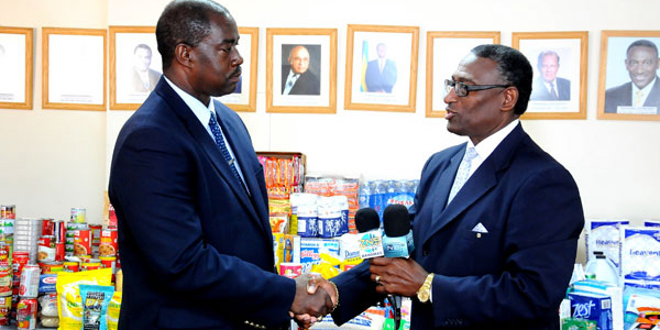 NEMA Director Capt. Stephen Russell and Minister for Agriculture V. Alfred Gray.