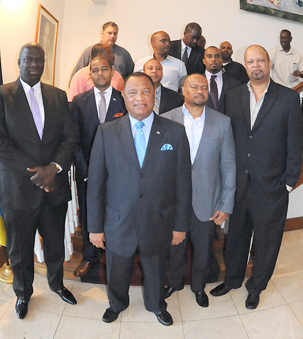 Prime Minister Christie, centre, in group photo with the Gaming House Operators Association during their donation to Hurricane Relief efforts at the Office of the Prime Minister, October 13, 2015. (BIS Photo/Peter Ramsay)