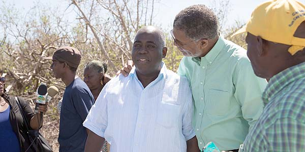 Deputy Prime Minister, The Hon. Philip  E. Brave Davis, joined Mr. Williams to survey restoration progress and the opening of the  temporary school.
