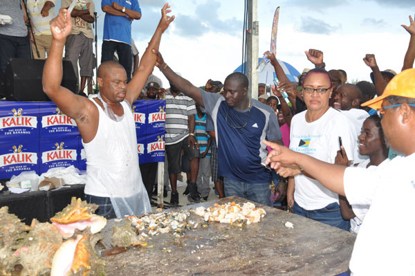 WINNER DECLARED – Joseph Tate is seen being declared the winner of the 43rd annual Conch Cracking Competition on Monday in McLean's Town. (BIS Photo/Vandyke Hepburn)