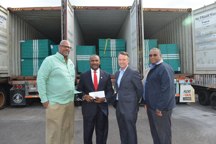 Ed Fields (SVP of Public Affairs and Retails), Paul Burke (President & Managing Director) Craig Tony Gomez (President of the Bahamas Red Cross) Ivan James (VP of Supply Chain Management).