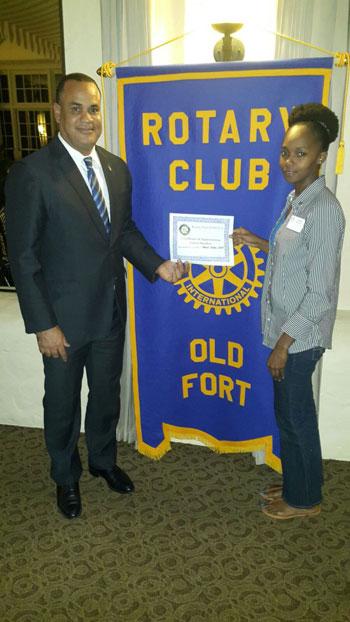 The Hon. Michael Halkitis and Rotarian Latoya Mitchell