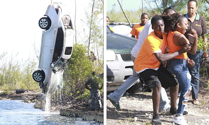 Shots of that silver Honda vehicle which police uncovered submerged in the Sea Breeze Canal on Saturday. photo by Tribune242.com