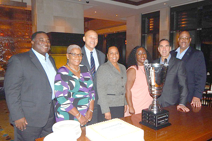 American Airlines and its partners at LPIA receive the Customer Cup Award for the third quarter 2015. Pictured left to right are: Kevin McDonald, vice president – Facilities, Nassau Airport Development Company (NAD); Deborah Coleby, vice president - Operations, NAD; Tyrone Sawyer, senior director – Airlift Development, Bahamas Ministry of Tourism; Caroline Hollingsworth, general manager – American Airlines, Bahamas; Aretha Allen, general manager, Envoy, Bahamas; Art Torno, senior vice president – International and Cargo, American Airlines; and Milo Butler, general manager – Airport Authority.