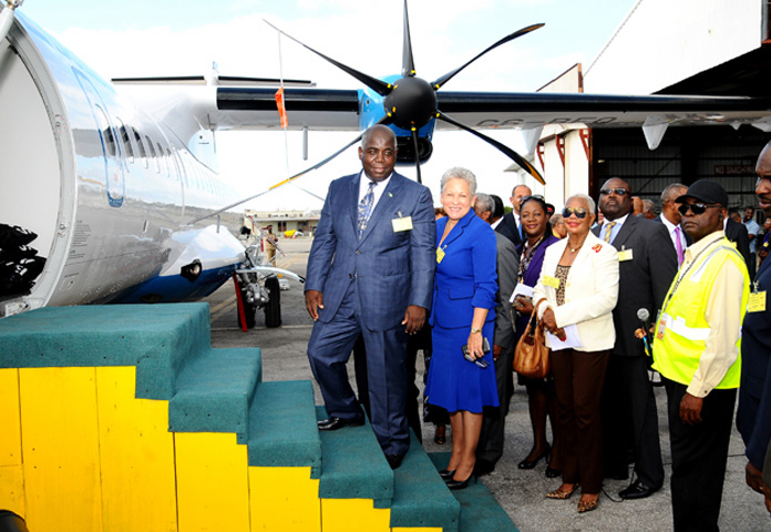 Deputy Prime Minister and Minister of Works and Urban Development Philip Davis and Minister of Transport and Aviation Glenys Hanna-Martin are pictured among other officials near the new Bahamasair aircraft.