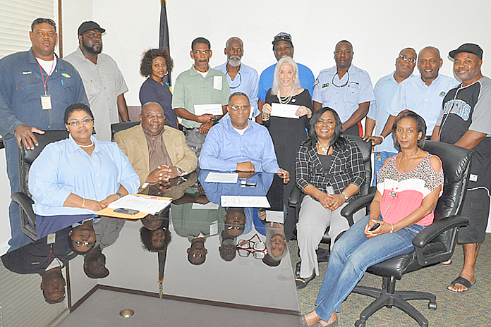 Pictured with the Minister for Grand Bahama Dr. Michael Darville (seated centre) are representatives of the Junkanoo Committee, and groups who received additional seed funding, December 24, 2015 at the Ministry for Grand Bahama. (BIS Photo/Vandyke Hepburn).