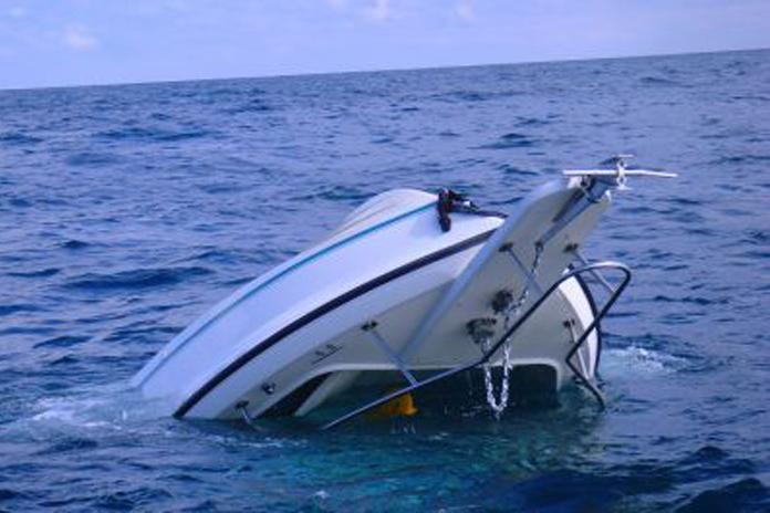 the capsized 21' Pursuit off Holland