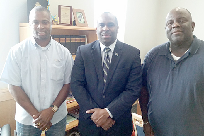 Abaconians are making their roads safe. Bahamas Striping Group of Companies is in Abaco applying thermoplastic beads and cat eyes on all the dangerous curves. Show from left to right: Mr. Atario Mitchell, President of Bahamas Striping Group of Companies, Mr. Renardo Curry, Parliamentary Secretary in the Office of the Prime Minister and Member of Parliament for North Abaco, Mr. Philmore Poitier, Inspector, Ministry of Works.