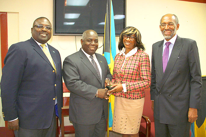 American Bar Association President Paulette Brown meets Deputy Prime Minister and Minister of Works and Urban Development the Hon. Philip Davis, centre, in a courtesy call at the Ministry's offices, January 21, 2016. Also pictured is Minister of State in the Ministry of Works and Urban Development Arnold Forbes, left, and Dr. Peter Maynard, head of the Law Department at the College of The Bahamas. Ms. Brown is a participant in the two-day, 4th Annual Arbitration and Investment Summit-Caribbean, Latin American and other Emerging Markets at COB library that opens January 22. (BIS Photo/Patrick Hanna)