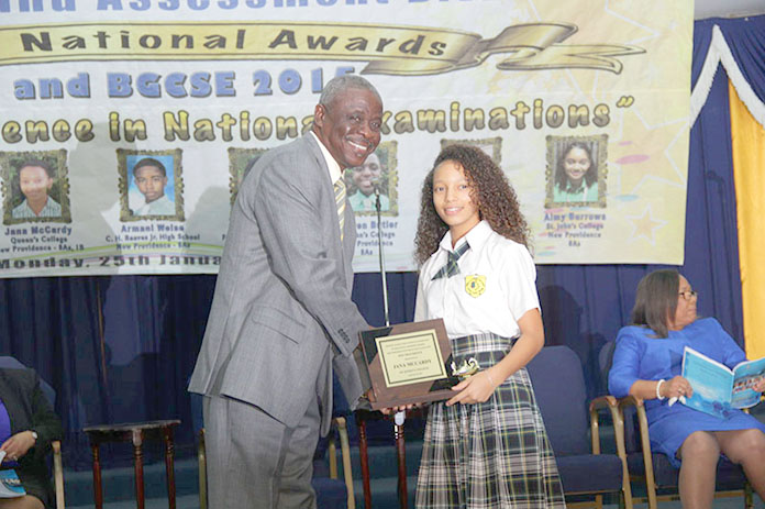 Director of Education, Lionel Sands presents Jana McCardy of Queen's College with a plaque at the 2015 BJC and BGCSE National Awards Presentation Ceremony.  Ms. McCardy was the 2015 Independent School Candidate with the Best BJC Overall Results.  She received 8As and 1B.  (BIS Photo/Raymond A. Bethel, Sr.)