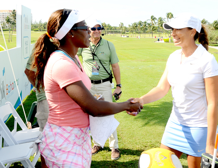 Bahamian golfer Georgette Rolle, left, shakes hands with fellow golfer Cheyenne Woods on Thursday morning, in the qualifying round of the Pure Silk-Bahamas LPGA Classic at the Ocean Club Golf Course, Paradise Island, January 25-31, 2016.  (BIS Photo/Kemuel Stubbs)