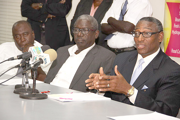 Minister Gray addressing a press conference.