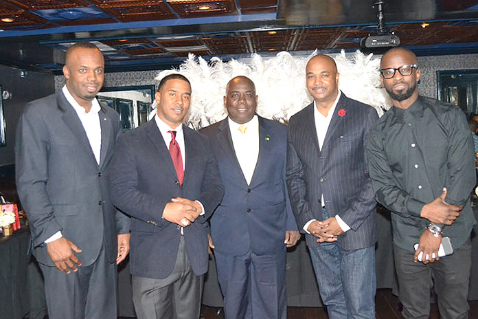 ATLANTA, Georgia -- Enroute to Tokyo, Japan, Deputy Prime Minister the Hon. Philip Davis had an overnight layover in Atlanta, Georgia, where he attended a reception with Bahamas Consul General to Atlanta Randy Rolle in honour of Kawan K.P. Pratjher, a producer who has been nominated for a Grammy Award. Pictured from left to right: Consul General Rolle, Kawan K.P Prather. Deputy Prime Minister Davis, Atlanta City Councilman Kwanza Hall and Producer Bryan Michael Cox, former Grammy Award winner, with roots are in Acklins and Crooked Island, who was involved in last year's Talent and Modelling show that was promoted by Pia Rolle.