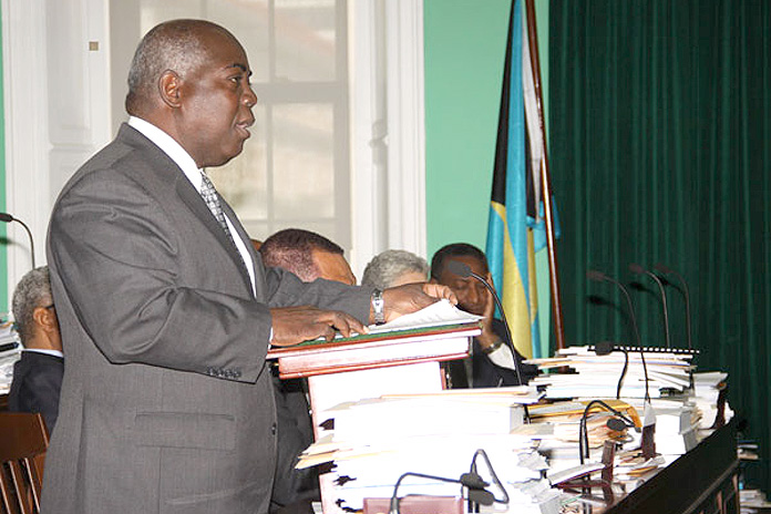 Deputy Prime Minister and Minister of Works and Urban Development the Hon. Philip Davis, announces Management Services Agreement for BEC in the House of Assembly on February 3, 2016. (BIS Photo/Patrick Hanna)