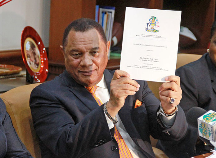 """Mr. Christie holding the report that he characterized as """"landmark"""" in nature. (Photo: BIS)"""