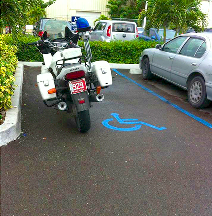 Police motorcyclist with no respect for the disable! WHAT IS THIS?