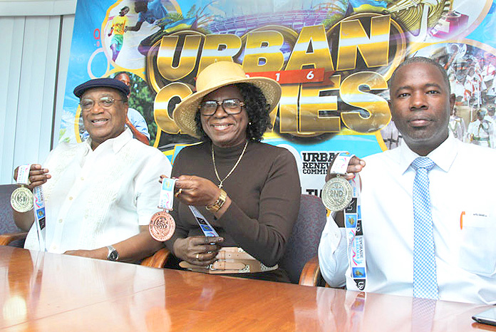 """NASSAU, The Bahamas -- Urban Renewal Commission Co-Chairpersons Algernon Allen (left) and Cynthia Pratt along with the Urban Renewal Commission's Sporting League Coordinator Wilton Russell, Jr., announced plans for the First Annual Urban Games dubbed """"Love Games"""" Track and Field Meet, in conjunction with the Urban Renewal Foundation -- to take place at the Thomas A. Robinson National Stadium, Saturday, February 13, from 9:00 a.m. to 8:00 p.m. The games aim to create camaraderie and provide opportunities for persons from the inner city to participate in a nationally-recognized initiative. Participants will receive medals and ribbons for their participation. (BIS Photos/Derek Smith)"""