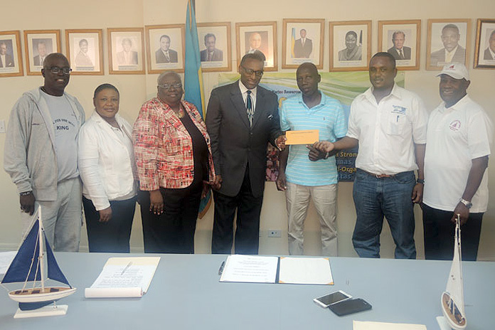 From left at the announcement and check presentation ceremony: Dr. Philip McPhee, Regatta Consultant, Ministry of Agriculture; Cephas Cooper, Under Secretary, Ministry in the Ministry of Agriculture; Cindy Gay, Regatta Desk Representative; Rena Glinton, Permanent Secretary, Ministry of Agriculture; Minister Gray and two representatives from the regatta association in Farmers Cay, Exuma; and to the far right, Daniel Strachan, Commodore of the Family Island Regatta Committee. The check presentation and announcement of the Sir Durward Knowles National Junior Regatta was held at the Ministry of Agriculture, Friday, 29th January 2016.