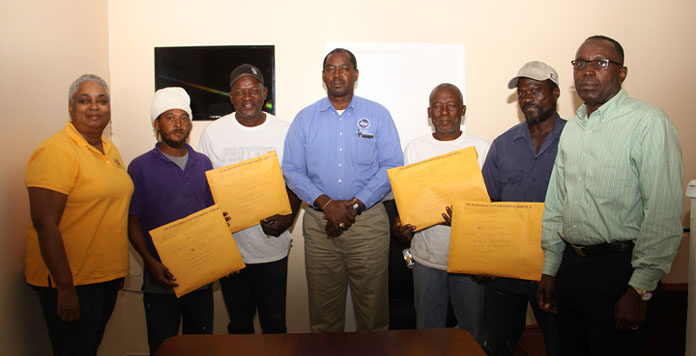 Contractors mobilized for family island hurricane construction efforts.