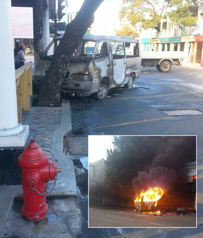 Taxi burst into flames on Bay Street this morning.