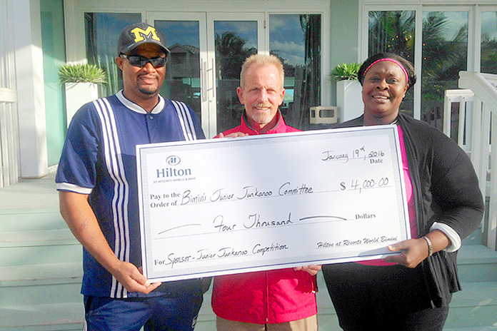 Bimini Junkanoo Committee receive a cheque following their victory.