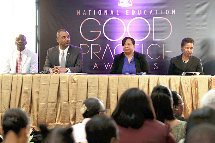 The Minister of Education, Science and Technology the Hon. Jerome Fitzgerald is shown (second left) at the launch of the National Education Good Practice Awards. Also pictured from left are Lionel Sands, Director; Donella Bodie, Permanent Secretary and Dr. Pandora Johnson.