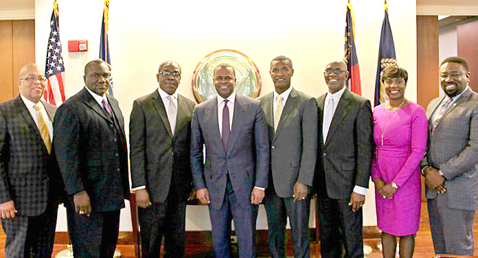 During a courtesy call on Atlanta Mayor Kaseem Reed, pictured from left to right: Pastor Dale Moss, Church of God of Prophesy; Rev. Delton Fernander, Pastor, New Destiny Baptist Church; Pastor Deanza Cunningham (Non-Denominational); Mayor Reed; Rev Randford Patterson, Pastor of A.M.E. Zion and President of the Bahamas Christian Council; Father James Palacios; Mrs Monique Major Vanderpool, Deputy Consul General; and Mr.Robert Pinder, Cultural & Student Relations Attache.