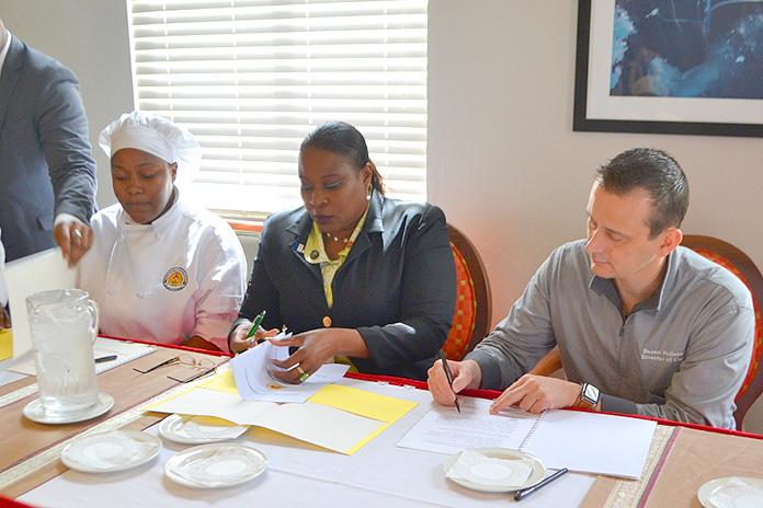 Chef Addiemae Farrington, Apprentice Coordinator CHMI, Mr. Clarence Albury, Director of Training & Development, Lyford Cay Club, Katiusia Johnson, Student Apprentice, COB, Dr. Sophia Rolle, Interim Executive Director, CHMI and Chef Pascal Hollander, Director of Cuisine & Operations, Lyford Cay Club.