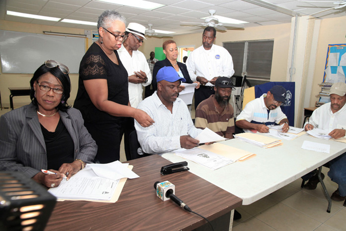 Contracts were signed Thursday, February 25, 2016 in Crooked Island for the repairs to Government buildings damaged by Hurricane Joaquin, which passed through the Central and Southeast Bahamas, October 2015. Pictured from left are Francita Neeley, Island Administrator, Crooked Island; Melanie Roach, the National Repairs and Reconstruction Unit; the Hon. V. Alfred Gray, Minister of Agriculture and Marine Resources and Member of Parliament for MICAL; the Hon. Hope Strachan, Minister of Financial Services and Local Government and Captain Stephen Russell, Director, the National Emergency Management Agency, NEMA. Contractors seated from left are Lorenzo Moss, Whitney Scavella, Clinton Scavella and Ernel Heastie. (BIS Photo/Derek Smith)