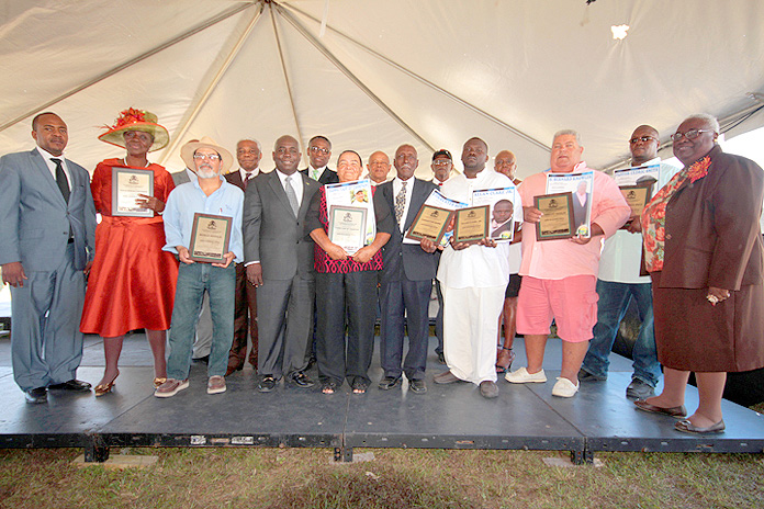 Cabinet Ministers and Members of Parliament with Bahamians recognized as outstanding farmers, during the opening ceremony for The Bahamas National Agricultural Marine Resources and Agri-Business Expo 2016, on March 10, 2016, at the Gladstone Road Agricultural Centre. (BIS Photo/Eric Rose)