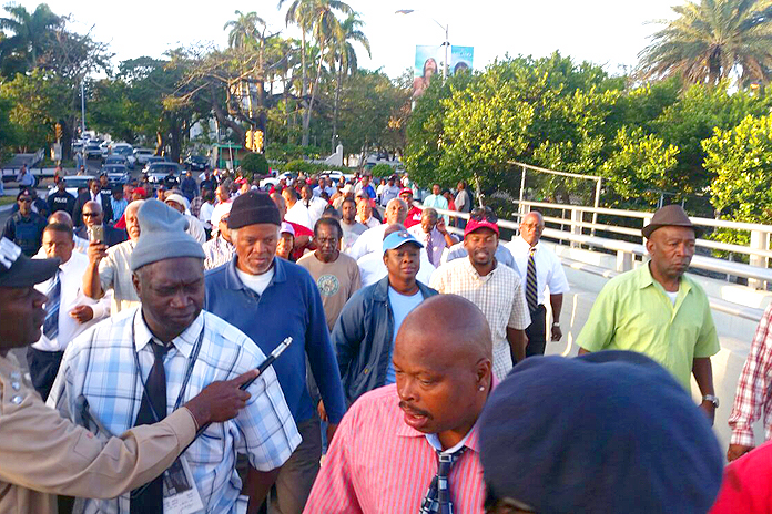 Scores of workers marched with Minnis over the Paradise Island Bridge in protest to the blocking of access to public beach on the island.