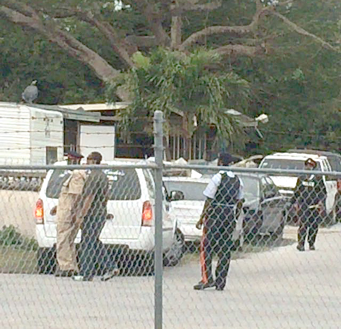 Police outside the home on Grand Bahama following a double homicide this morning.