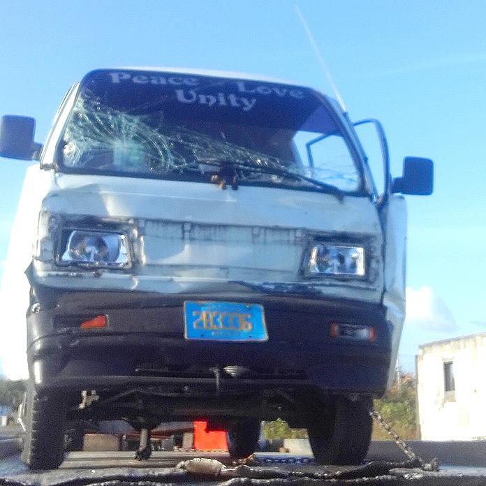 Company van collide with truck.
