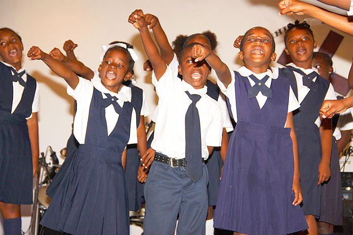 Grades 1 and 2 give a musical tribute to Paul Turnquest, former principal of United Estates Primary School. (BIS Photo/Patrick Hanna)