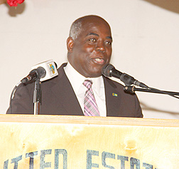 The Deputy Prime Minister and Minister of Works and Development the Hon. Philip Davis gives remarks at the retirement ceremony for Paul Turnquest, former educator. (BIS Photo/Patrick Hanna)