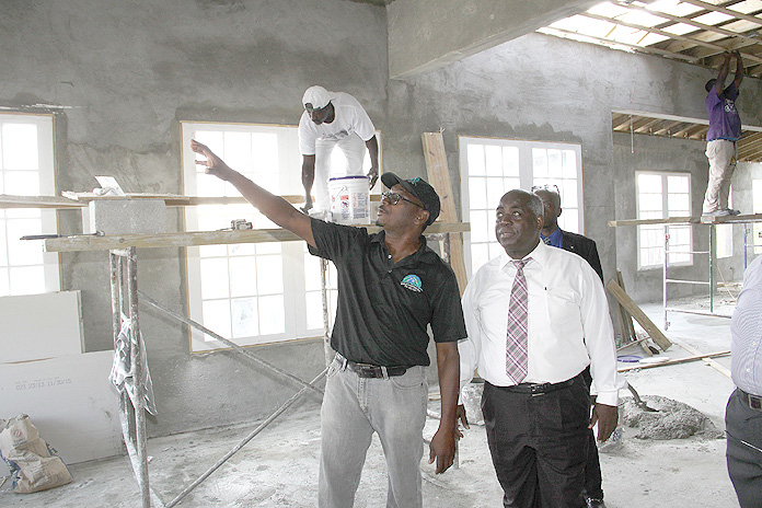 Kirk Williams of World Construction and Development Company is pictured making a point to the Hon. Philip Davis, Deputy Prime Minister and Minister of Works and Urban Development during a tour of work on the San Salvador International Airport.  (BIS Photo/Patrick Hanna)