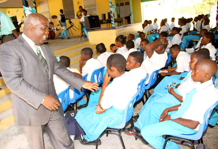 The Hon. Philip Davis, Deputy Prime Minister and Minister of Works and Urban Development, is shown greeting students of South Andros High school. BIS Photo/Patrick Hanna