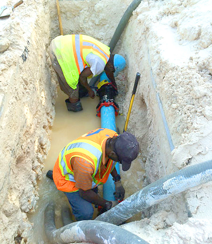 Workers repairing a leak on Blue Hill Road on New Providence. (Photo: WSC/Barefoot Marketing).