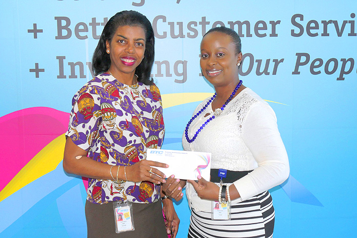 Myra Mitchell, Primary School Student of the Year Committee Member and BTC Project Manager; and Indira Collie, Manager of Public Relations, BTC.